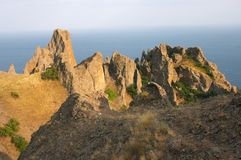 Volcano karadag rocks. Sea. Sun rays Royalty Free Stock Image