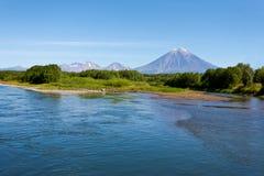 Volcano Koryaksy and river Avacha on Kamchatka. Stock Images
