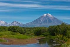 Volcano Koryaksy and river Avacha on Kamchatka. Royalty Free Stock Photography