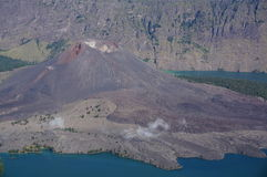 Volcano in lake. Volcano surrounded by lake and larger volcano Stock Images