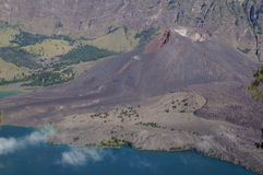 Volcano in lake. Volcano surrounded by lake and larger volcano Royalty Free Stock Photos
