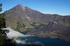 Volcano in lake. Volcano surrounded by lake and larger volcano Royalty Free Stock Photography