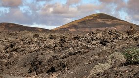 Volcano with lava fields in the foreground. Lanzarote, Canary Islands royalty free stock photos
