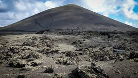 Volcano with lava fields in the foreground. Lanzarote, Canary Islands royalty free stock photo