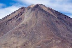 Volcano Licancabur andf cloudy blue sky. Volcano Licancabur with a clear blue sky in Eduardo Avaroa Andean Fauna National Reserve, Bolivia, at the border with Stock Images