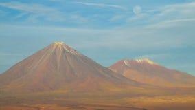 Volcano Licancabur in Chile desert. Volcano Licancabur in Chile. Volcanic landscape, snow covered hight volcano top Stock Photography