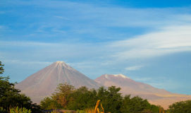 Volcano Licancabur. In Chile. Volcanic landscape, snow covered hight volcano top Stock Photos