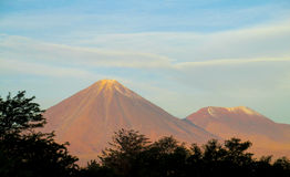 Volcano Licancabur. In Chile. Volcanic landscape, snow covered hight volcano top Royalty Free Stock Photos