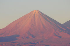 Volcano Licancabur by San Pedro de Atacama at sunset time. Royalty Free Stock Photo