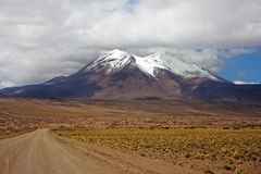 Volcano Miniques. Seen from the North, situated in Los Flamencos National Reserve, Chile Stock Photos