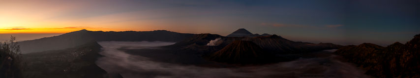 Volcano Mount Bromo panorama, just before sunrise. Clouds meandering in crater stock photo