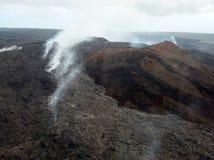 Volcano Mountain med dimma Arkivfoton