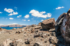 Volcano near the island of Santorini, Greece. Big stones on a volcano near the island of Santorini, Greece Royalty Free Stock Images