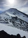 View of the summit of the Avachinsky volcano from a slope at an altitude of 2000 meters stock photos
