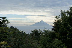 Volcano Osorno, lake Llanquihue, Patagonia, Chile. Volcano Osorno with lake Llanquihue in a mist of clouds seen from Puerto Varas, Patagonia, Chile Stock Photo