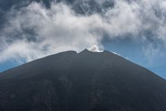 Volcano of Pacaya with Smoke and Blue Sky.  Royalty Free Stock Photo