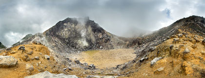 Volcano panorama with a dramatic sky. Sibayak volcano Royalty Free Stock Photo