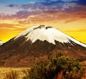 Volcano Parinacota at sunset. Chile, South America. Royalty Free Stock Image