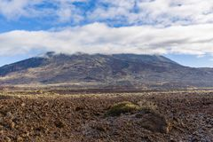 Volcano Pico del Teide is Spain`s highest mountain. Its height is approximately 7500 m, which is 3718 m above sea level. Tenerife, Canary Islands royalty free stock photo