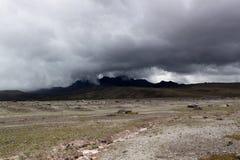 Volcano in rain clouds. Ecuador, South America Stock Image