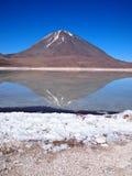 Volcano reflection in Laguna Verde. Reflection of Licancabur volcano in Laguna Verde (green lagoon) in the desert near Uyuni in Bolivia Royalty Free Stock Photography