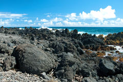 Volcano rocks on beach at Hana on Maui Hawaii Royalty Free Stock Photography