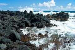 Volcano rocks on beach at Hana on Maui Hawaii Stock Photos