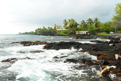 Volcano rocks with ocean and palm trees during the storm on Hawa Royalty Free Stock Images