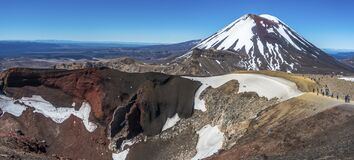 Volcano and rocks partly covered by snow