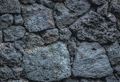 Volcano stone texture background bricks in the wall stock image