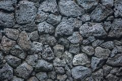 Volcano stone texture background bricks in the wall royalty free stock image