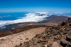 Volcano summit above the clouds Royalty Free Stock Photos