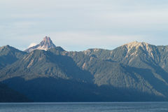Volcano summit above the lake Royalty Free Stock Photos