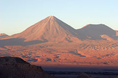 Volcano at sunset, Atacama Desert, Chile. The Atacama Desert is a volcanic plateau in Chile (South America) west of the Andes mountains. It is the driest desert Stock Photo
