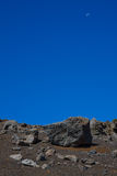 Volcano terrain looking like moonscape. Daylight moon on a late afternoon blue sky in the Haleakala Crater National Park Crater, Oahu, Hawaii. A view from royalty free stock photography