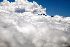 Volcano top above clouds Stock Photo