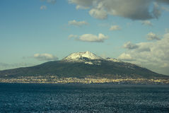 Volcano Vesuvius with snow. From view Sorrento peninsula, Italy royalty free stock images