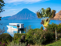 Volcano View with Boat. A boat waits to take people out on Lake Atatlan, Guatemala Stock Image