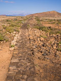 Volcano Walking Path, Canary Islands. Footpath made of volcanic stone, created to enable tourists to explore an area of volcanoes without damaging the Stock Photography