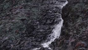 Volcano and waterfall of Hirvas tilt down stock footage