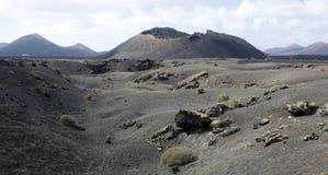 Volcanoe. Panoramic view into lava fields and volcanoes, Lanzarote Stock Image