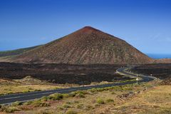 Volcanoe in Lanzarote, Spain, landscape scene. Volcanic landscape and winding road in Lanzarote, the Canary islands, Spain Stock Photo