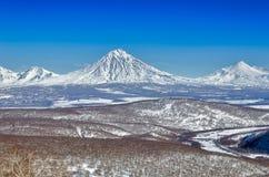 Volcanoes av den Kamchatka halvön, Ryssland. Arkivbild