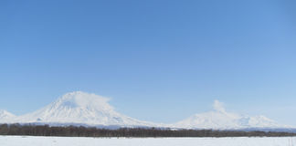 Volcanoes of Kamchatka. They are called home - so they look like winter royalty free stock photos