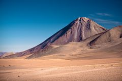 Volcanoes Licancabur and Juriques, Chile. Volcanoes Licancabur and Juriques on the border between Chile and Bolivia Royalty Free Stock Image