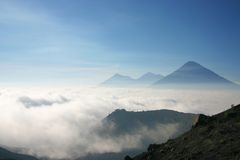 Volcanoes over a see of clouds. View from other volcanoes above a see of cloud, from the top of Pacaya mountain in Guatemala Royalty Free Stock Photography