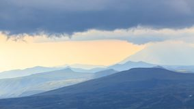 Volcanoes before a strength thunderstorm, Kamchatka, Russia royalty free stock photo
