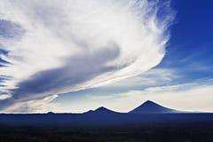 Volcanoes at sunrise Stock Image