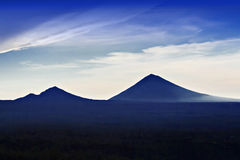 Volcanoes at sunrise Stock Photography