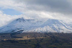 Volcanon mount Saint Helens. Volcano mount Saint Helens decapitated top with glacier and surrounding bogland with trenches and  in clouds Stock Photography